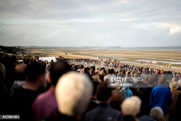 A large crowd watch from the enclosure as runners approach the finish at Laytown racecourse on September 5 2017 in Laytown Ireland Laytown racecourse...