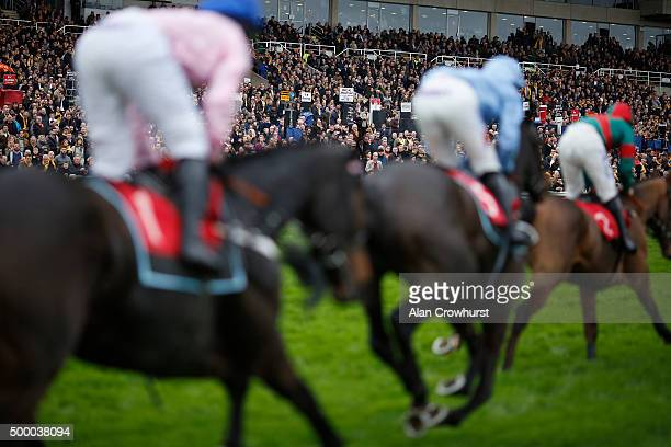 A large crowd watch the action at Sandown racecourse on December 05 2015 in Esher England