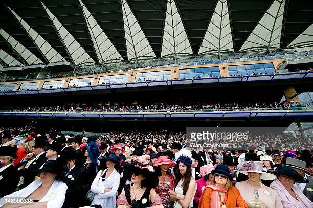 Large crowd watch the action during Royal Ascot at Ascot racecourse on June 19, 2012 in Ascot, England.