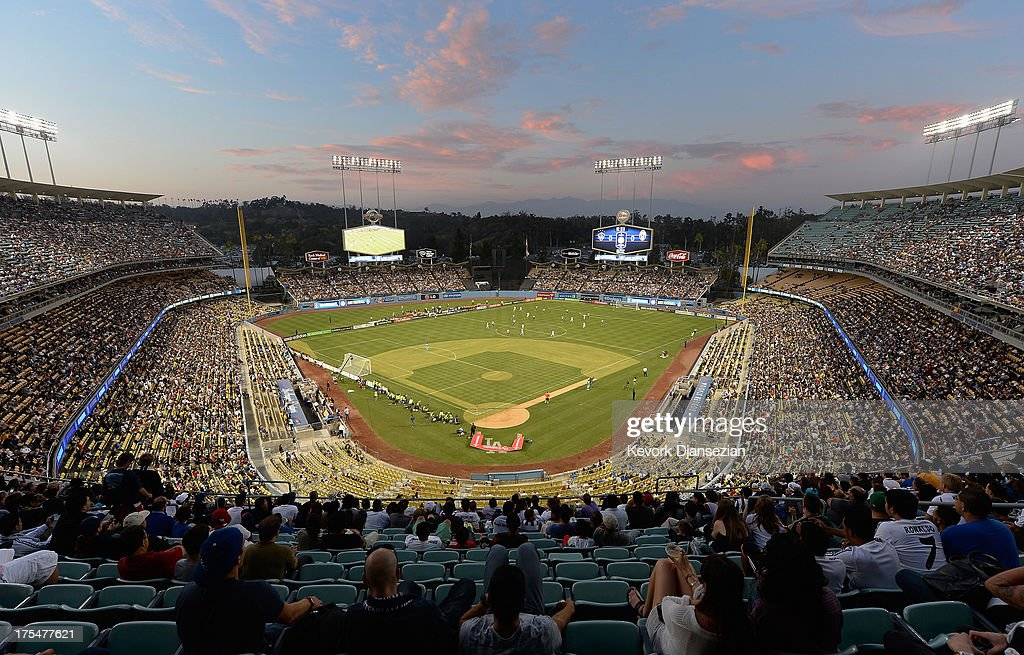A large crowd watches Juventus take on Los Angeles Galaxy during the 2013 Guinness International Champions Cup at Dodger Stadium on August 3, 2013 in Los Angeles, California. For the first time ever a doubleheader soccer match involving three European soccer clubs, Real Madrid, Everton and Juventus and a team from Major League Soccer, Los Angeles Galaxy, play on the baseball field where the Los Angeles Dodgers play their home baseball games.