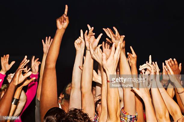 large crowd with hands up - arms raised stock pictures, royalty-free photos & images