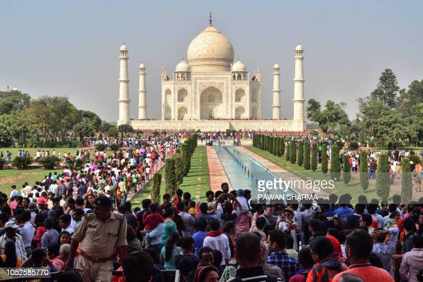 Large crowds are pictured at the Taj Mahal complex in Agra on October 20, 2018. - Nearly 50,000 people visited the site on October 20, Indian media...