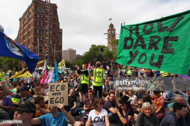 Large crowds block the streets during an Extinction Rebellion protest in the Sydney Central Business District on October 07 2019 in Sydney Australia...