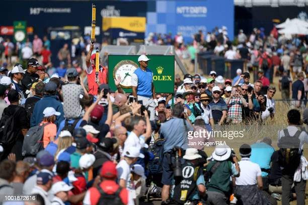 Large crowds follow Tiger Woods of the United States during round one of the 147th Open Championship at Carnoustie Golf Club on July 19, 2018 in...