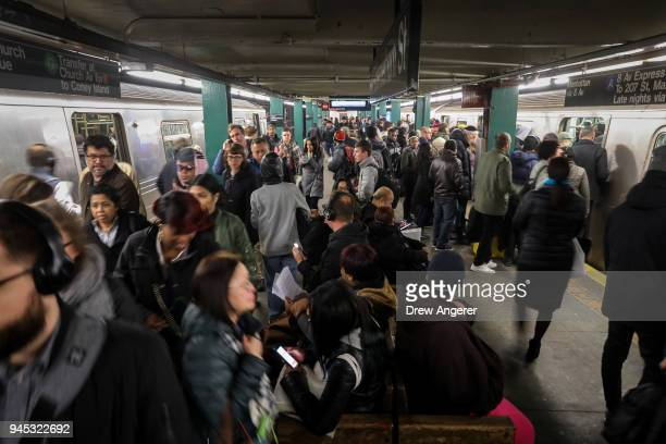 Large crowds gather during the morning rush hour at the HoytSchermerhorn subway station April 12 2018 in the Brooklyn borough of New York City A...