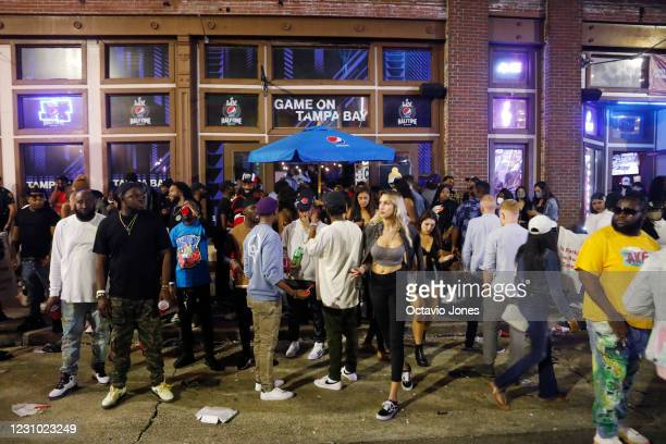 Large crowds gather in the Ybor City district on the eve Super Bowl LV on February 7, 2021 in Tampa, Florida. In addition to social social...