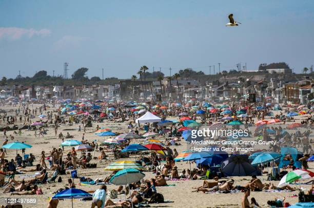 Large crowds gather near the Newport Beach Pier in Newport Beach on Saturday April 25 2020 to cool off during the hot weather despite the coronavirus...