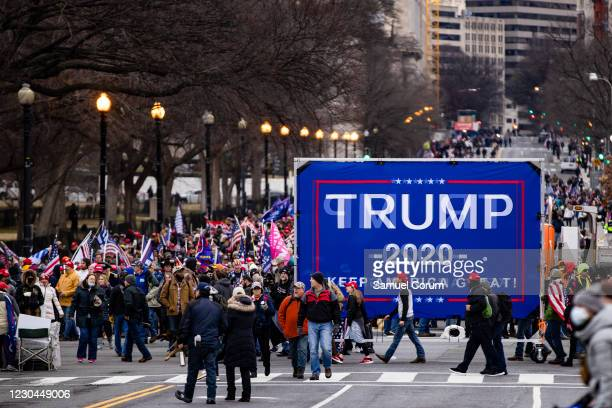 Large crowds of supporters of President Donald Trump make their way to a rally on the Ellipse, between the White House and Washington Monument, on...