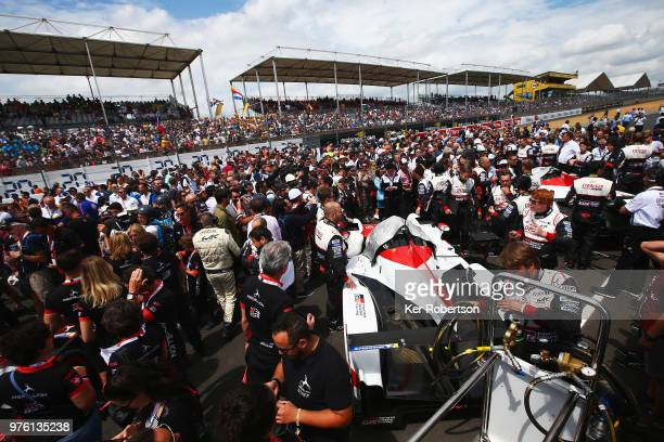 Large crowds surround the Toyota Gazoo Racing TS050 Hybrid of Mike Conway Kamui Kobayashi and Jose Maria Lopez and The Toyota Gazoo Racing TS050...
