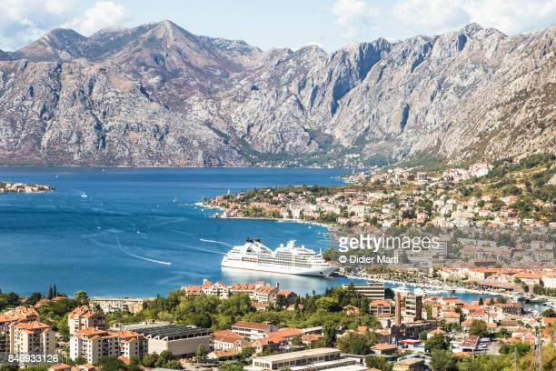 large cruise ship anchored in kotor in montenegro - didier marti stock photos and pictures