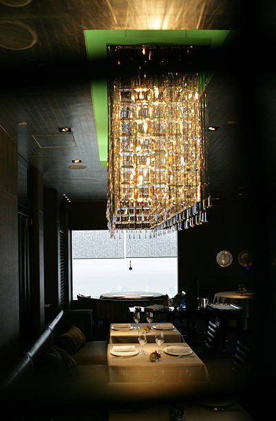 A Large Crystal Chandelier Hangs Above The Main Dining Room Pictures
