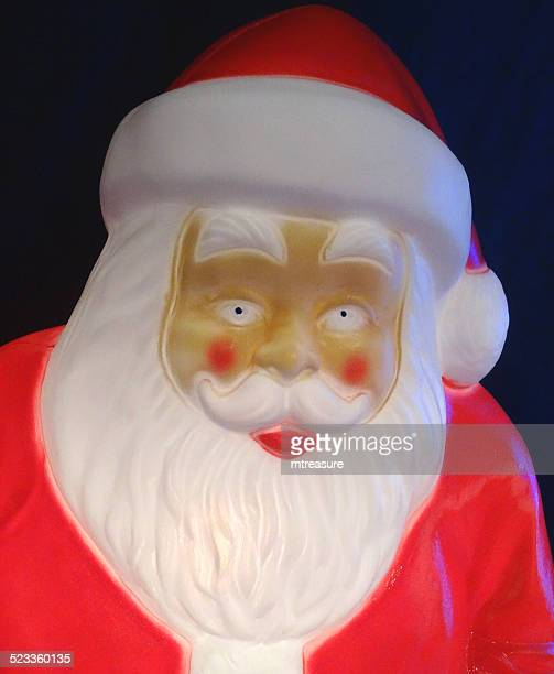 large cuddly cartoon illimunated santa claus / father christmas, plastic-light, winter-display - cartoon santa claus stock photos and pictures