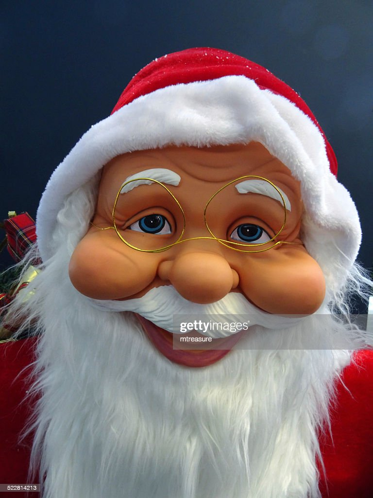 Large cuddly life-size cartoon Santa Claus / Father Christmas, white-beard, winter-display : Stock Photo