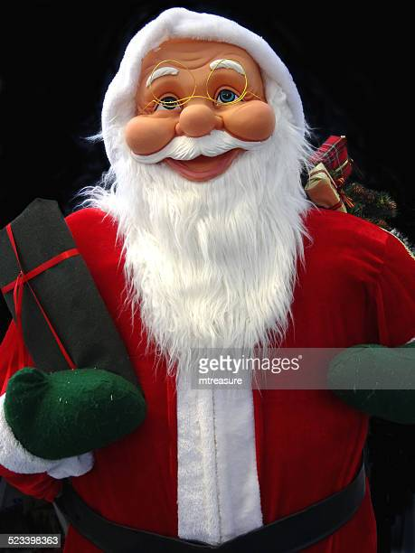 large cuddly life-size cartoon santa claus / father christmas, white-beard, winter-display - cartoon santa claus stock photos and pictures
