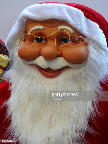 large cuddly life-size cartoon santa claus / father christmas, white-beard, winter-display - cartoon santa claus stock photos and pictures