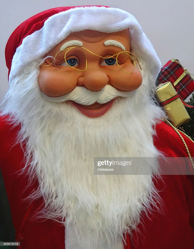 Large cuddly life-size cartoon Santa Claus / Father Christmas, white-beard, winter-display : Stock Photo