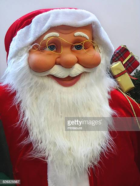 large cuddly life-size cartoon santa claus / father christmas, white-beard, winter-display - fur trim stock pictures, royalty-free photos & images