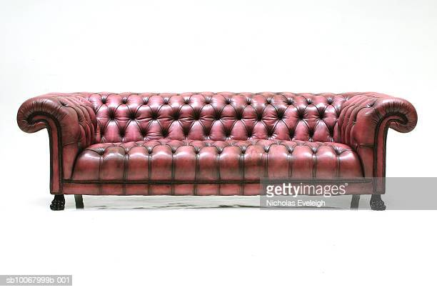 large custom made brown leather sofa on white background - ancho fotografías e imágenes de stock