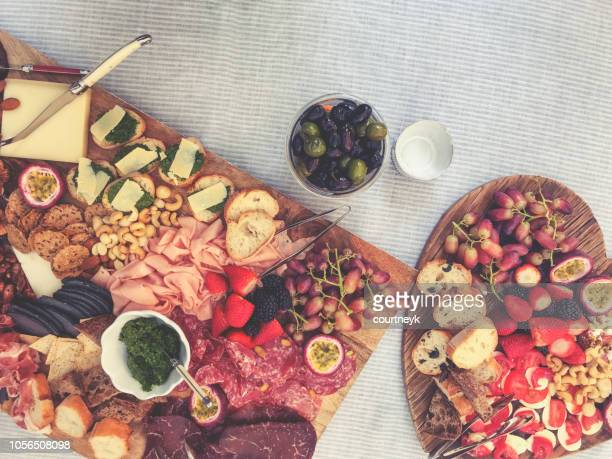 large cutting board with canapã©s. - salumeria stock photos and pictures