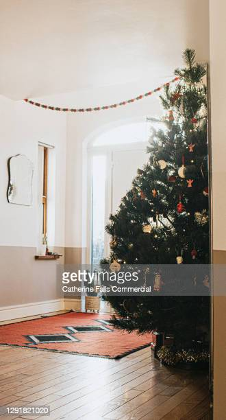 large decorated christmas tree in a hallway - symbolism stock pictures, royalty-free photos & images