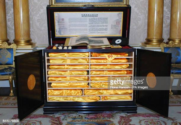 A large decorative box containing Antique Bibles in sixteen volumes of prints given by King George III to the Emperor of China in 1792 including a...