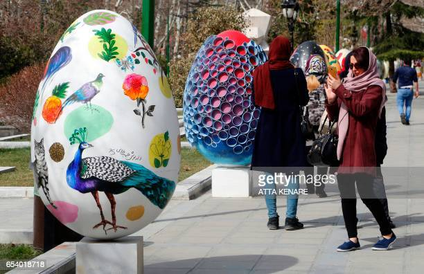 large decorative eggs displayed at the Mellat park during an event organised by the municipality of Tehran on March 16 ahead of the Persian new year...