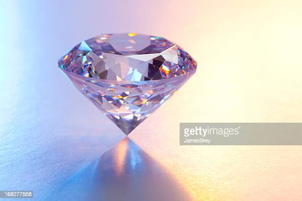 large diamond on reflective surface - diamond gemstone stock pictures, royalty-free photos & images