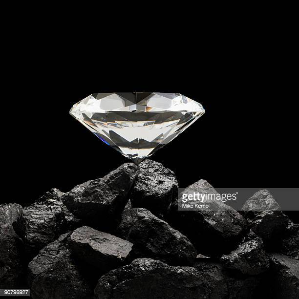 large diamond on top of a pile of rocks