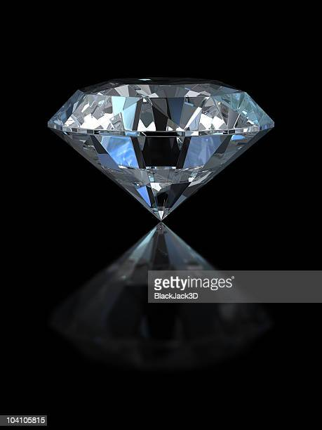 large diamond with reflection set against black background - diamond stock pictures, royalty-free photos & images