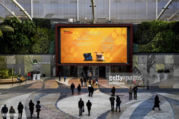 A large digital screen shows advertisements to visitors at the entrance to the Dolce Vita Tejo shopping mall operated by AXA Real Estate Investment...