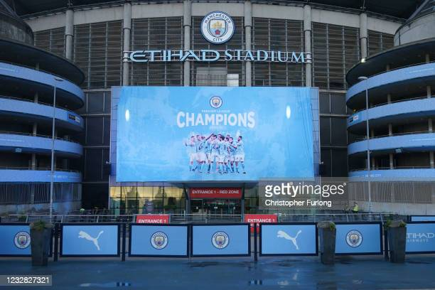 """Large display outside Etihad Stadium reads """"Champions"""" as Manchester City has been confirmed as Premier League champions for the third time in four..."""
