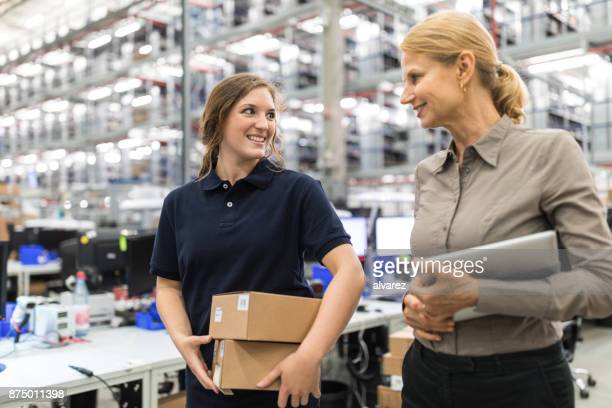 large distribution company employees walking together - foreman stock pictures, royalty-free photos & images