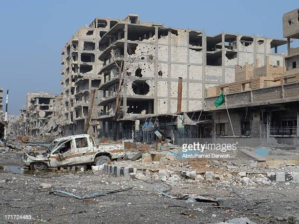 CONTENT] Large distruction in the main street of Dayr Az Zawr city east of Syria