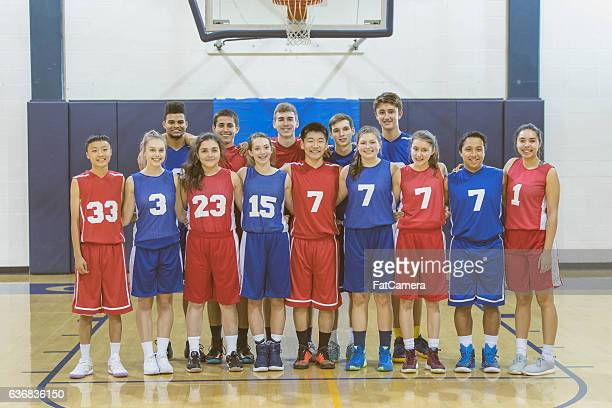 a large diverse group of high school athletes in uniforms - sports team stock pictures, royalty-free photos & images