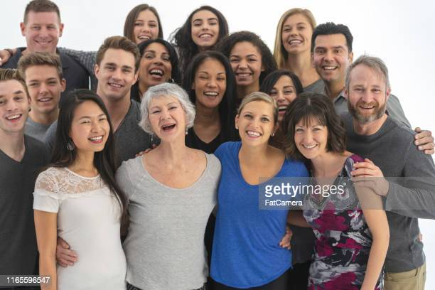 large, diverse group of people gathered indoors - fatcamera stock pictures, royalty-free photos & images