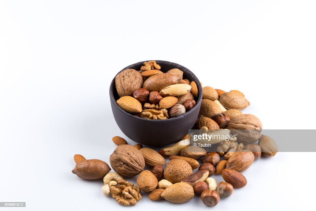 Large diversity of healthy nuts in a dark stone bowl - isolated : Stock-Foto