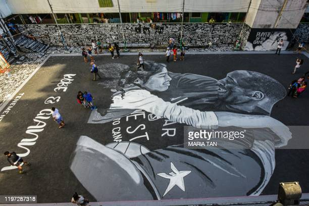 A large drawing shows US NBA basketball legend Kobe Bryant and daughter Gianna at a basketball court in Taguig south of Manila on January 29 2020...