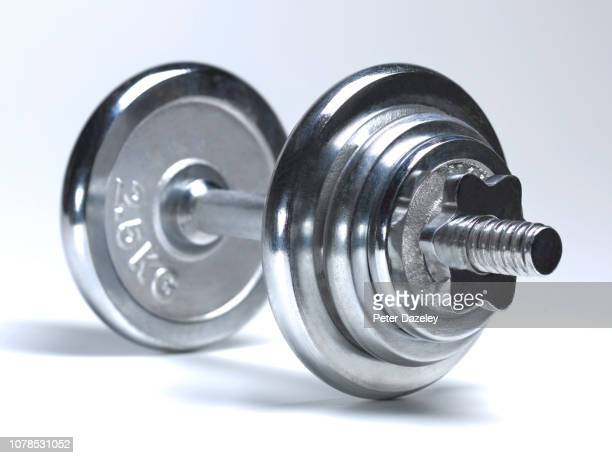 large dumbbells on white background - hand weight stock pictures, royalty-free photos & images