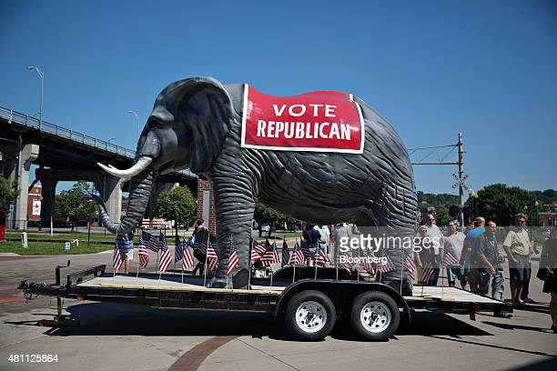 A large elephant stands near guests waiting to enter an event with Scott Walker governor of Wisconsin and 2016 Republican presidential candidate in...