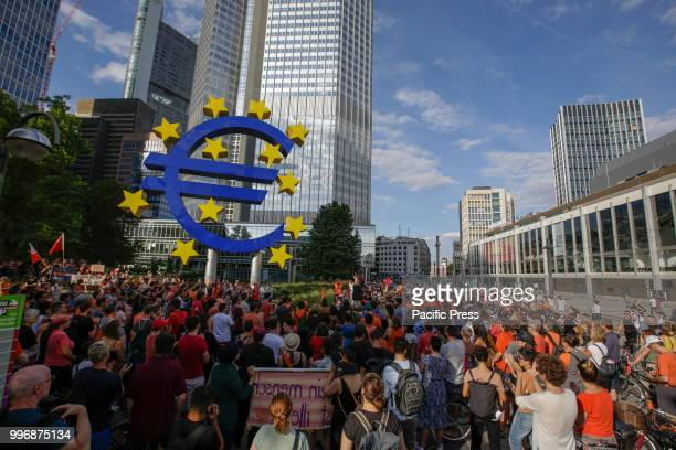 A large Euro sign outside the former seat of the ECB Around 800 protesters marched through Frankfurt to protest against the politics of the German...