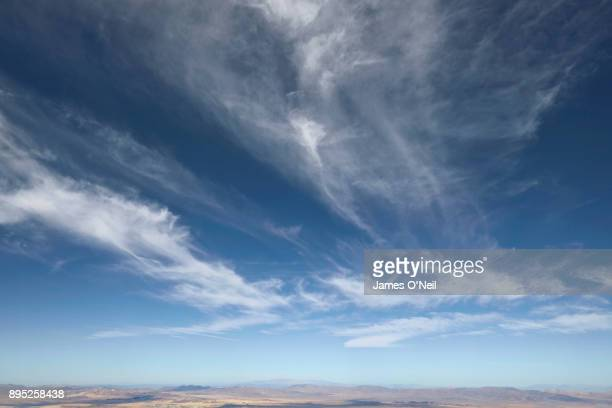 large expanse of blue sky and wispy clouds - moody sky stock pictures, royalty-free photos & images