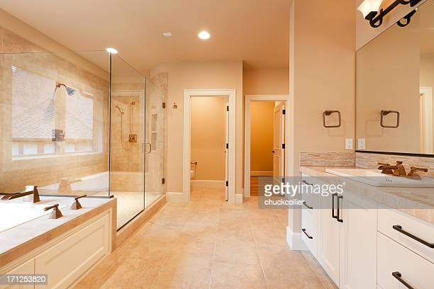 large expensive master bathroom - bathroom stock photos and pictures