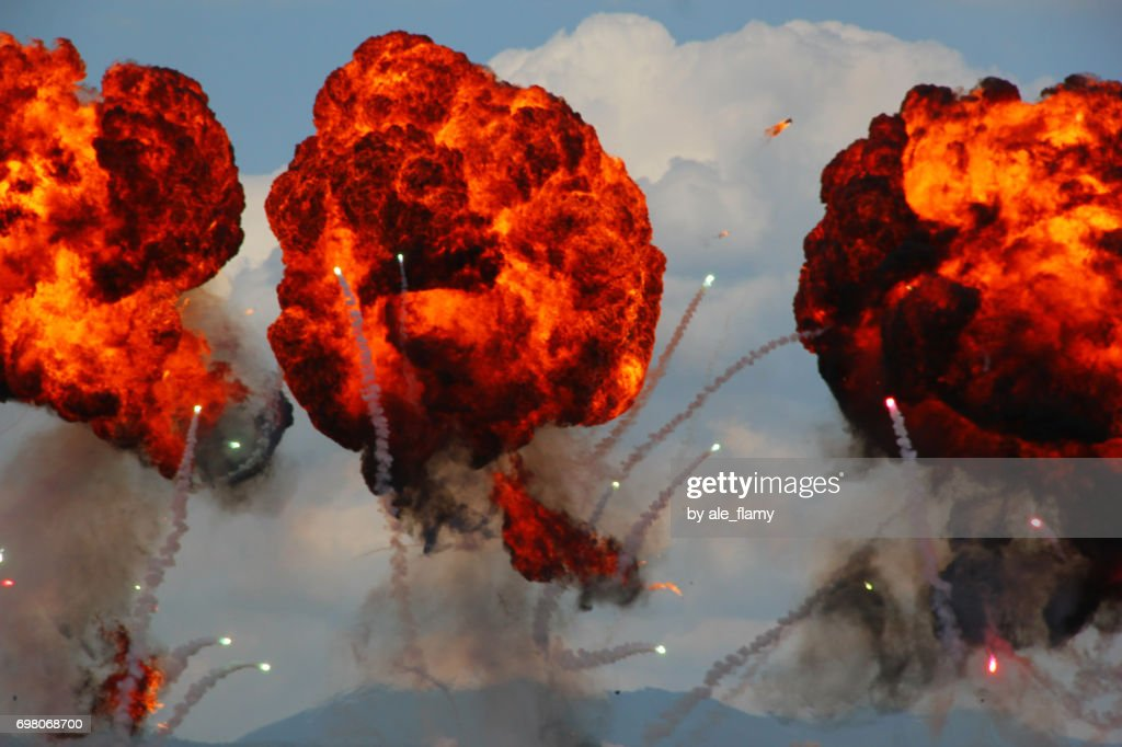 Large explosion made by fire bomb drops at an airshow display : Stock Photo
