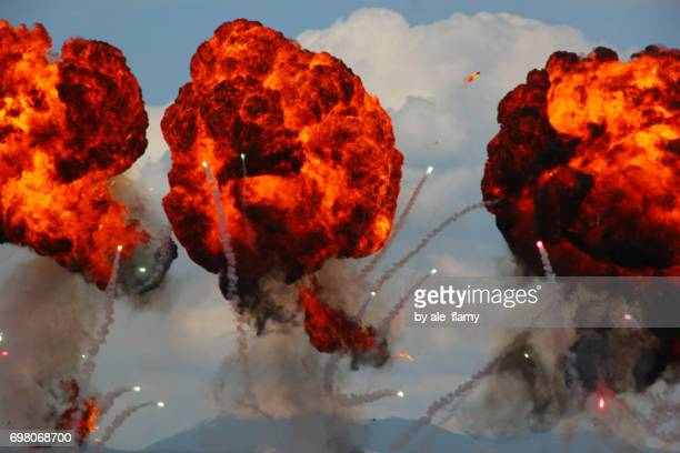 Large explosion made by fire bomb drops at an airshow display