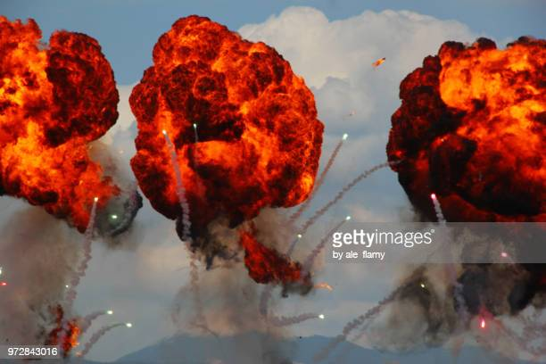 large explosion made by firebombs droped at an airshow display - military attack ストックフォトと画像
