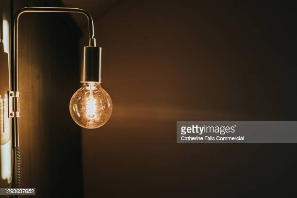 large exposed wall mounted lightbulb - lighting equipment stock pictures, royalty-free photos & images