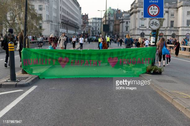 Large Extinction Rebellion banner that reads Climate emergency is seen at Waterloo bridge blocking the street during the Extinction Rebellion Strike...