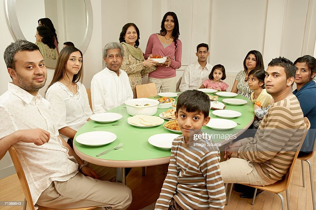 Beautiful Large Family At Dining Table : Stock Photo