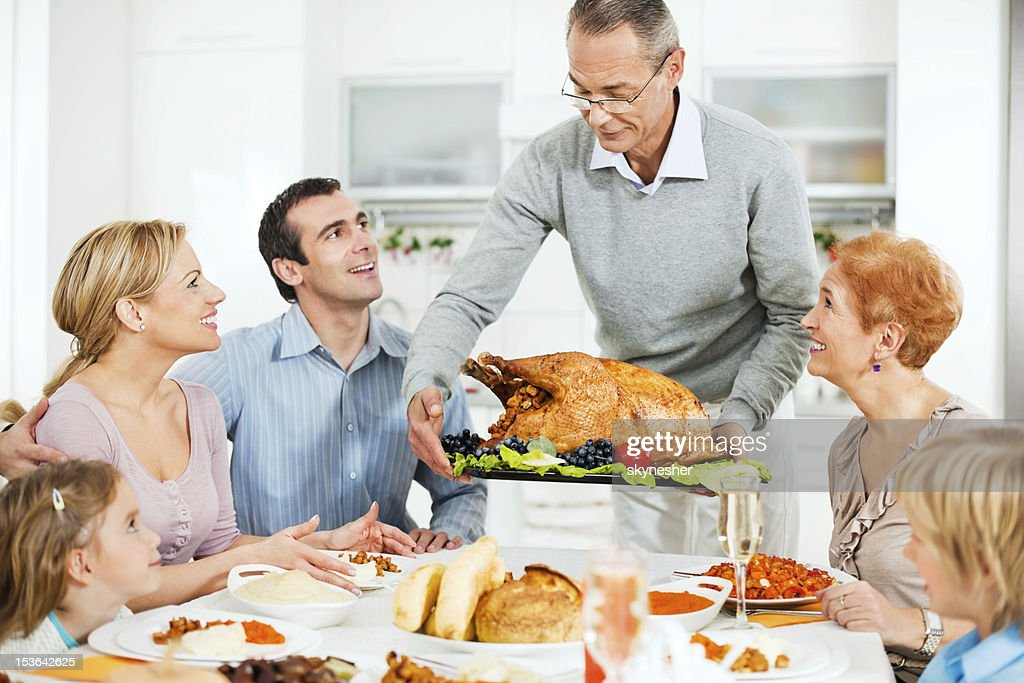 Large family at the dinner table for Thanksgiving day. : Stock Photo