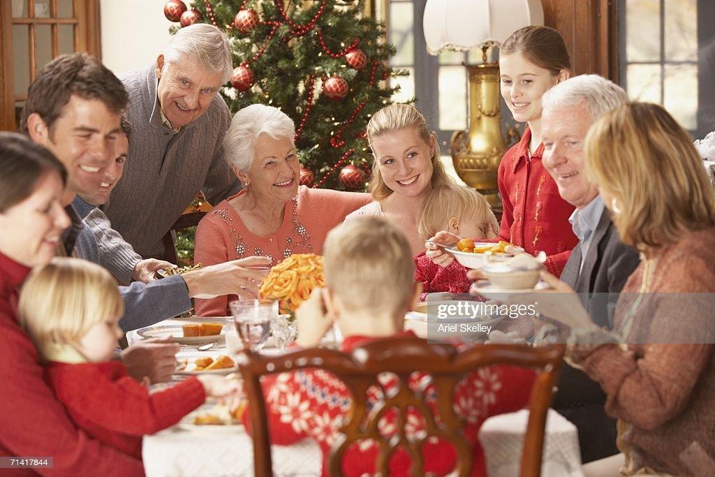 Large Family Eating Christmas Dinner Stock Photo